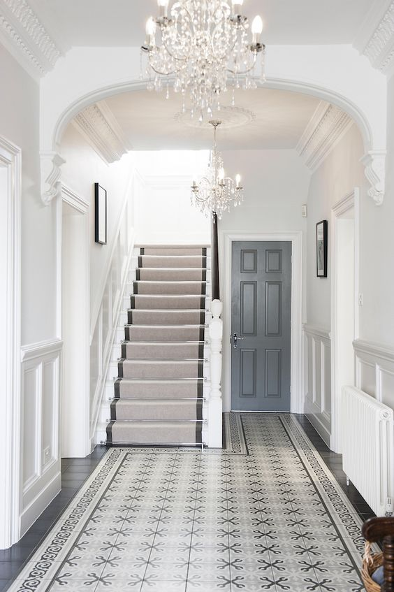 creating a welcoming hallway with patterned flooring